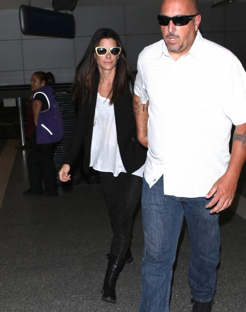 Sandra Bullock Arriving On A Flight At LAX