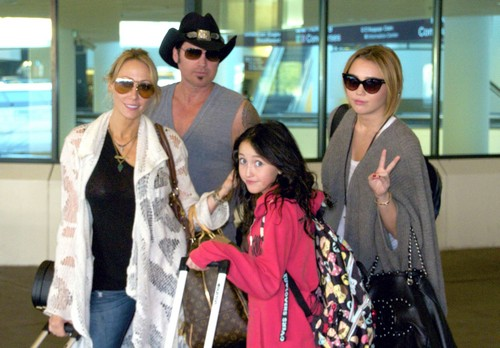 EXCLUSIVE: Miley Cyrus And Family Arriving On A Flight In Nashville