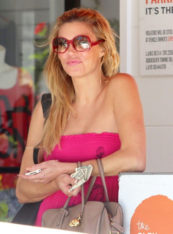 Brandi Glanville Waits For Her Car At The Glen Centre
