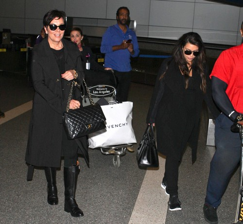 Kim Kardashian & Kris Jenner Arriving On A Flight At LAX