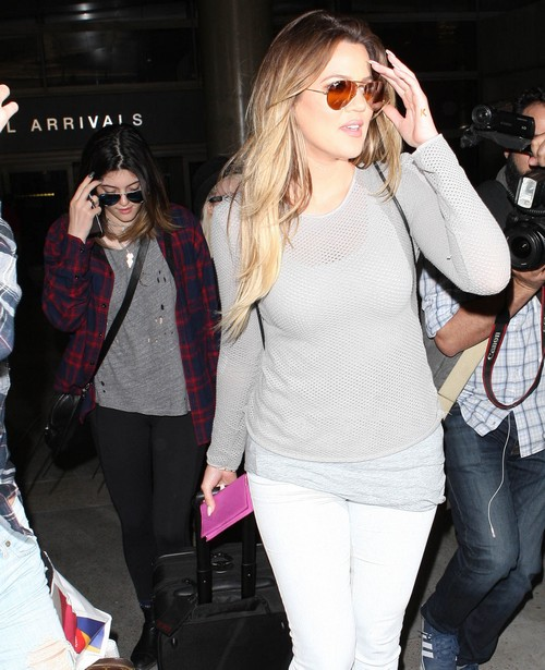 The Kardashian Girls Arriving On A Flight At LAX