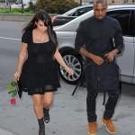 Kim Kardashian & Kanye West Don't Look Happy As They Reunite In Paris (PHOTOS)
