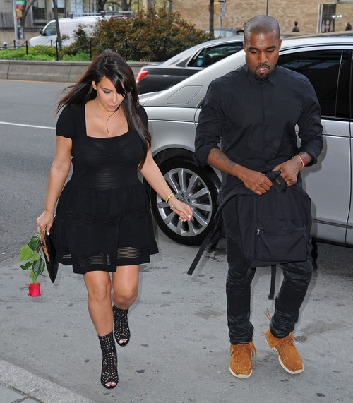 Kim Kardashian & Kanye West Don't Look Happy As They Reunite In Paris (PHOTOS)