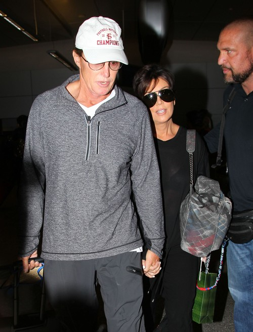 Kris & Bruce Jenner Hold Hands At LAX