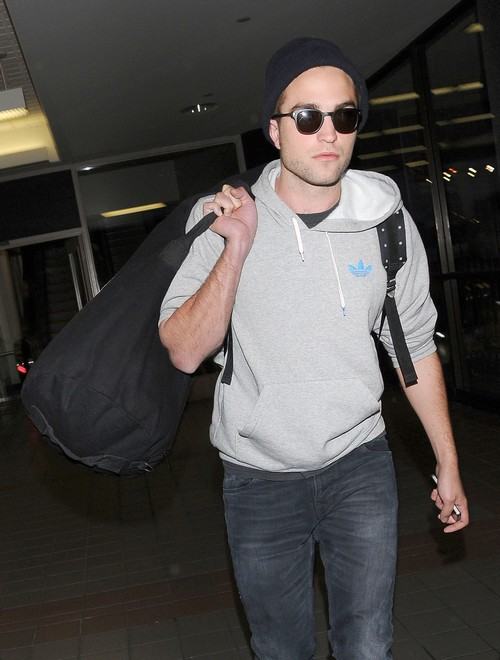Robert Pattinson Arriving On A Flight At LAX
