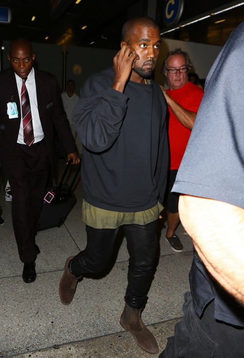 Kanye West & Kim Kardashian Touch Down At LAX