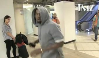 Kanye West Temper Tantrum Attacks TMZ Photographer At LAX (VIDEO)