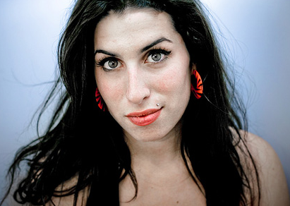 Amy Winehouse Was Adopting 10 Year Old Girl