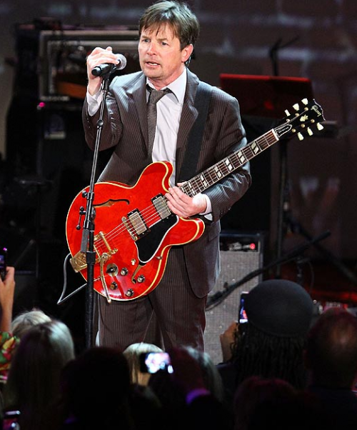 VIDEO: Michael J. Fox Does 'Johnny Be Goode' For Charity Event – Back To The Future, Again ( We LOVE It!)