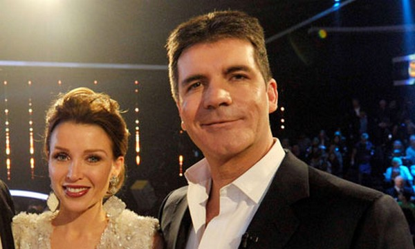 Simon Cowell with fellow The X Factor judge Dannii Minogue in 2010.