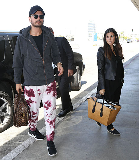 Kourtney Kardashian & Scott Disick Departing On A Flight At LAX