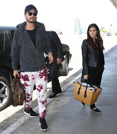 Kourtney Kardashian & Scott Disick Departing On A Flight At LAX