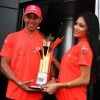 Lewis Hamilton with his girlfriend Nicole Scherzinger, display the trophy after the Turkish Formula One Grand Prix