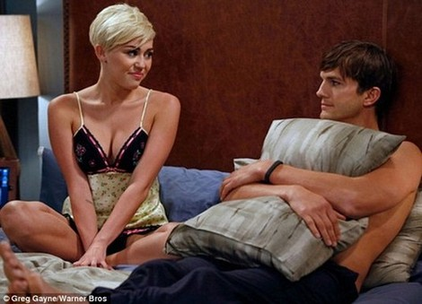 Miley Cyrus Is In Bed With Ashton Kutcher – Why? Read Below To Find Out! (Photo)