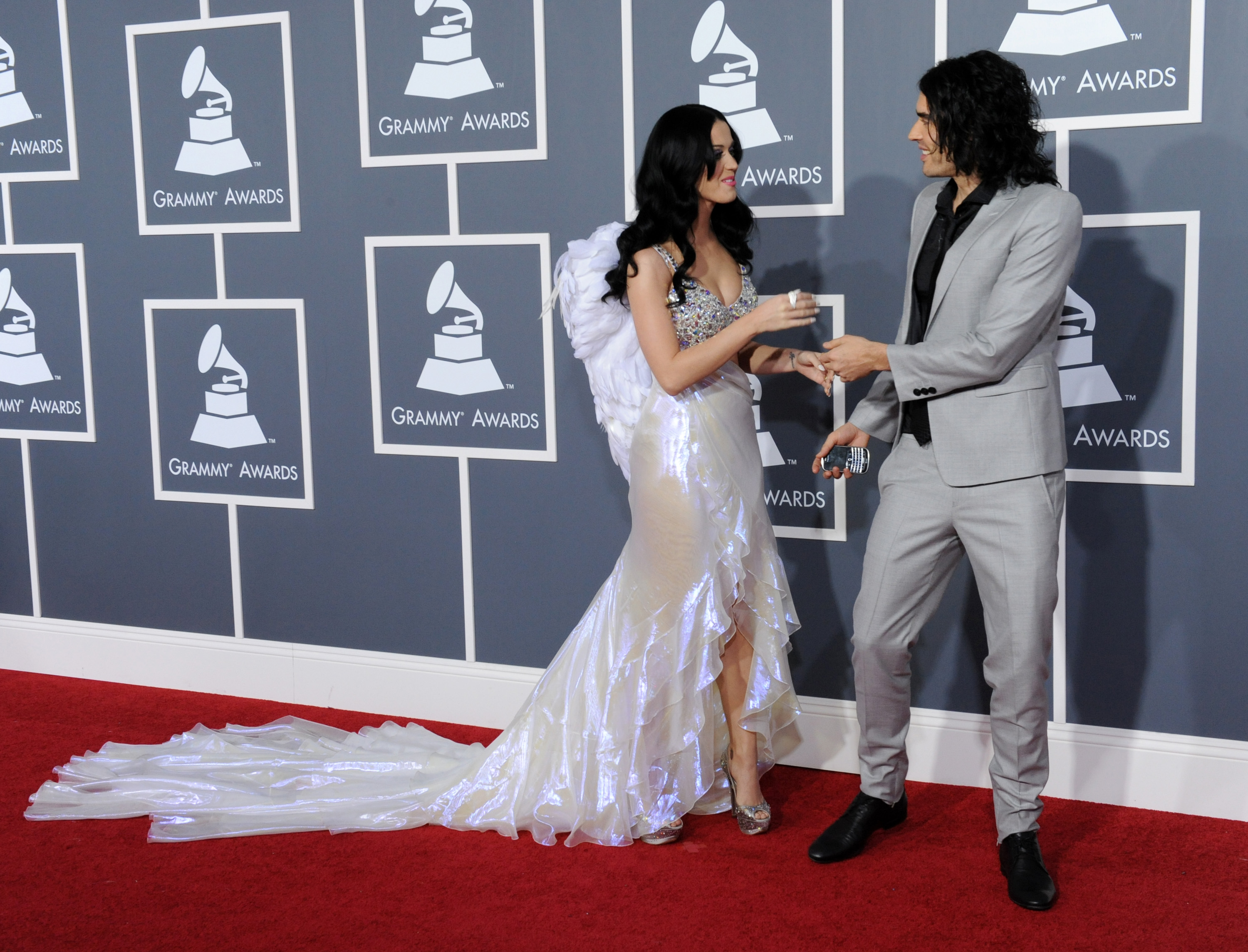Katy Perry greets husband Russell Brand at the 53rd annual Grammy Awards in Los Angeles