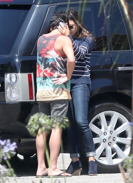 Ashton Kutcher and Mila Kunis Caught Kissing at a Party (Photos)