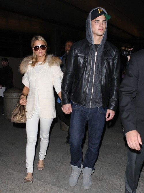 Paris Hilton and River Viiperi Arriving On A Flight At LAX