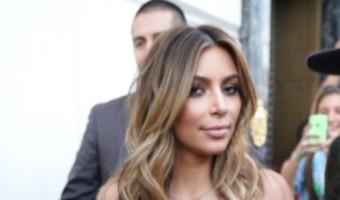 Kim Kardashian Displays Her Cleavage To The World (PHOTOS)