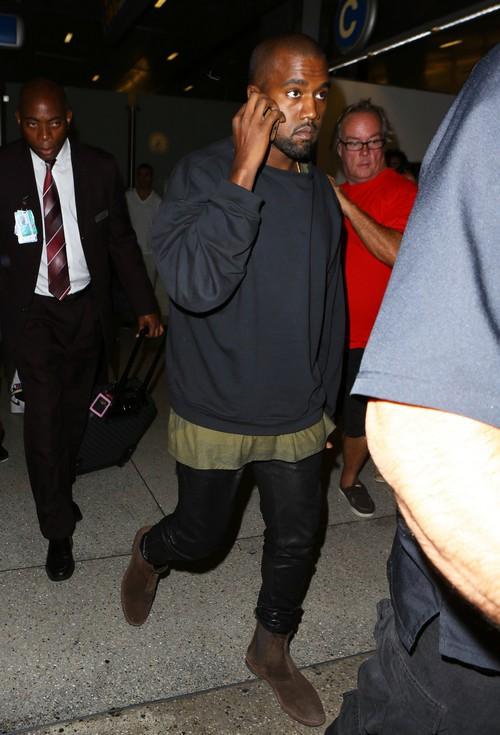 Kanye West & Kim Kardashian Touch Down At LAX