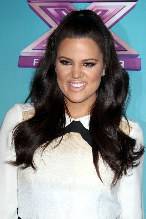 Khloe Kardashian Turns to the Bottle to Help Dull the Infertility Pain