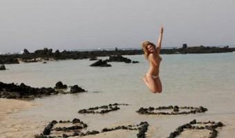 Bar Rafaeli TOPLESS Jumps For Joy On The Beach (Photo)